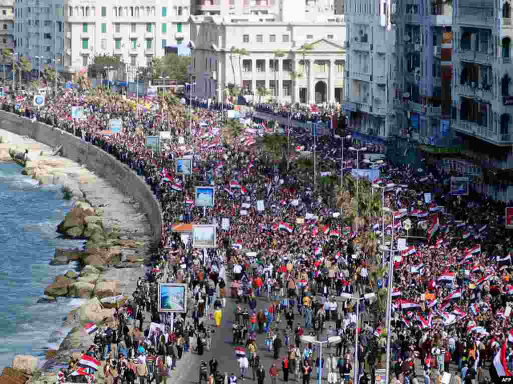 Antigovernment protesters march in the coastal city of Alexandria on February 11.