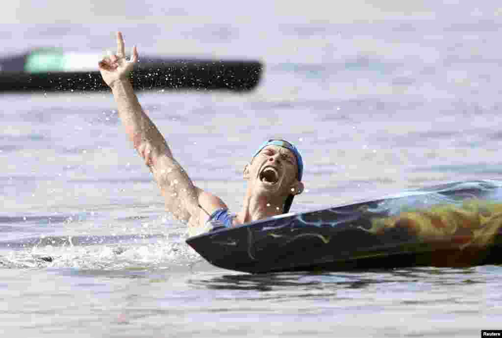 Yuriy Cheban of Ukraine roars in celebration after winning gold in the men's canoe 200-meter singles.
