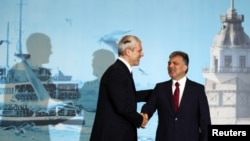 Turkish President Abdullah Gul (right) greets Serbian President Boris Tadic at the Southeast European Cooperation Process summit in Istanbul.