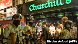 Riot police march in Wan Chai district, a touristic area where foreigners gather in bars, in Hong Kong on October 4, 2019