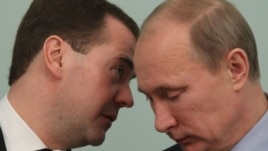 Prime Minister Vladimir Putin (left) and President Dmitry Medvedev