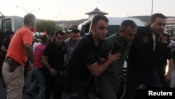 Soldiers suspected of being involved in the coup attempt are escorted by policemen as they arrive at a courthouse in the resort town of Marmaris on July 17.