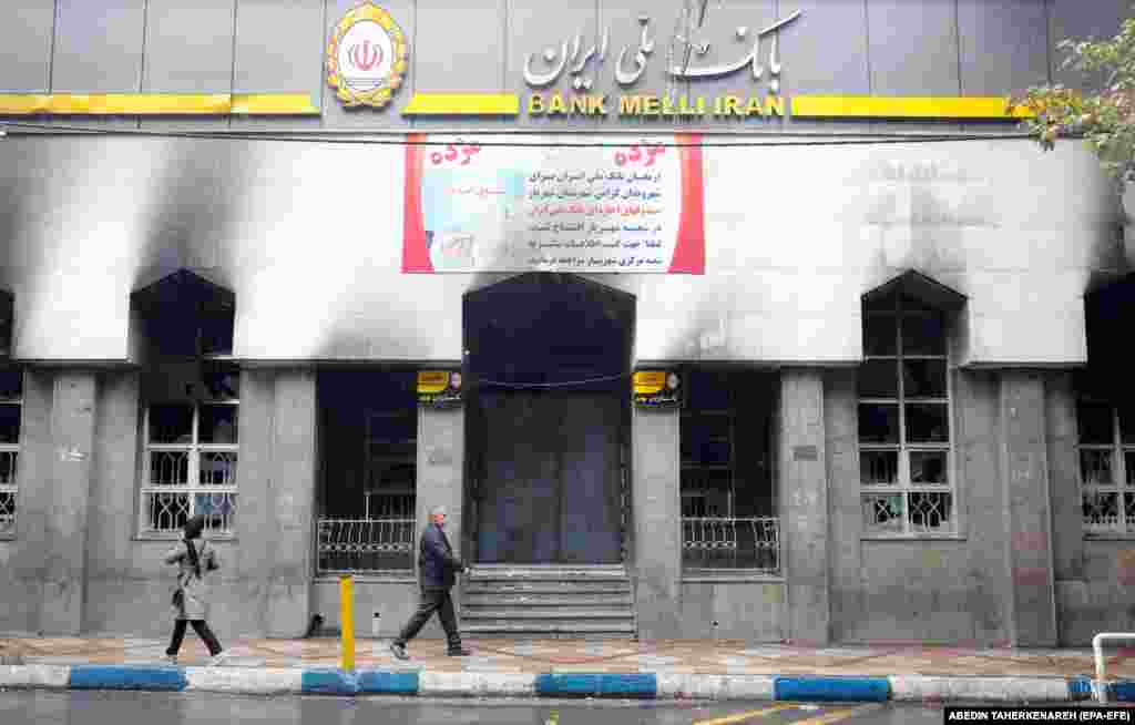 "A branch of the Iranian national bank in Shahriar that was burned during the protests. Iran's government blamed the unrest on a ""plot"" from some of Tehran's foreign foes: Saudi Arabia, Israel, and the United States."