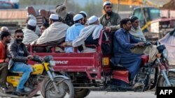 Worshippers leave the religious gathering in Lahore on March 13.