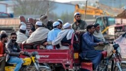 FILE: Worshippers leave a Tablighi Ijtema or religious gathering in Raiwind on the outskirts of Lahore on March 13.