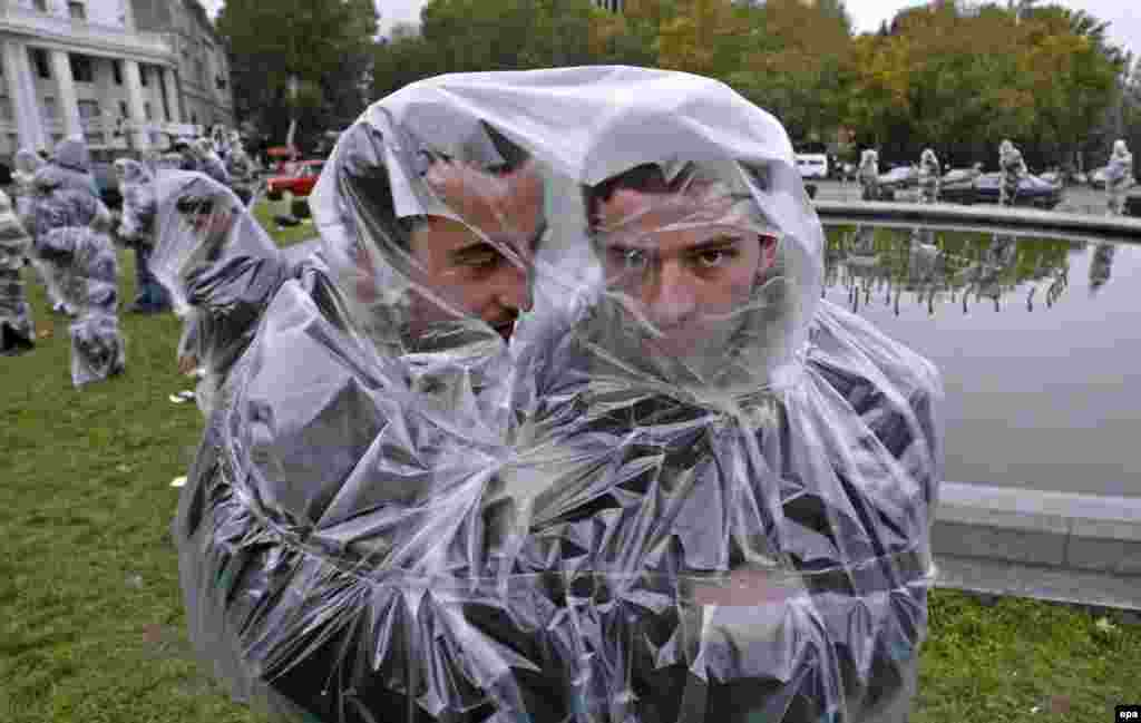 Georgian students wrapped in cellophane join in protests against the policies of President Sheverdnadze in Tbilisi on November 20.