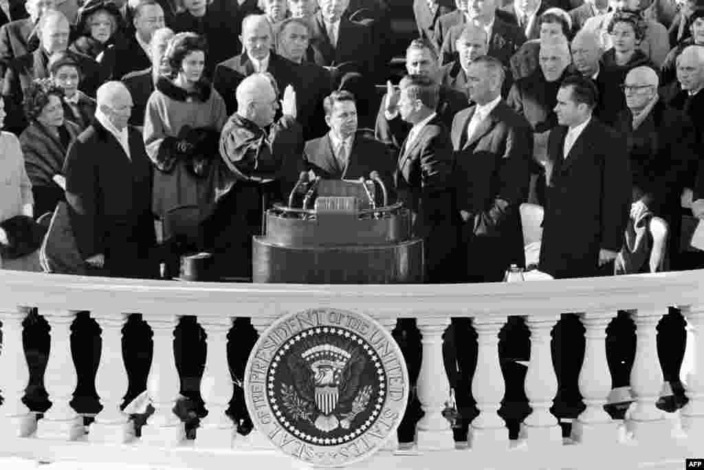 Kennedy is sworn in as the 35th U.S. president by Supreme Court Chief Justice Earl Warren in front of the Capitol in Washington D.C., on January 20, 1961.