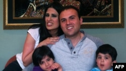 Saeed Abedini with his and his wife Naghmeh and their two children in an undated photo