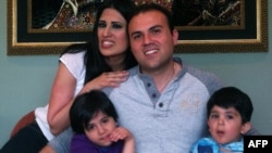 An undated picture of dual U.S.-Iranian citizen Saeed Abedini with his wife Naghmeh and their two children. He has been imprisoned in Iran since 2012.