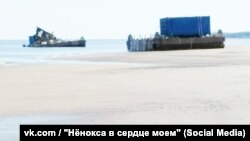 """This is what death looks like"": What appears to be a damaged blue shipping container, the kind that often appear in Defense Ministry promotional materials about missile launches, is shown in a photograph taken from a closed chat room on the Russian social media platform VK."