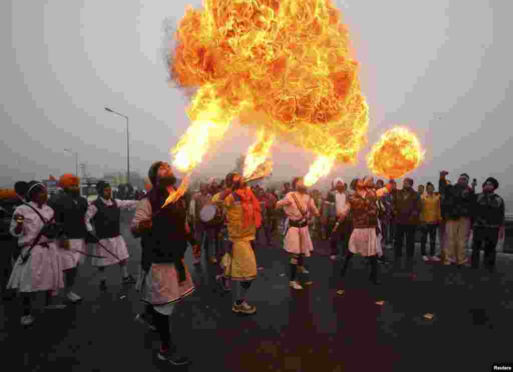 Sikh devotees show off their fire blowing skills during a religious procession ahead of the birth anniversary of Guru Gobind Singh in Jammu, on January 5. (Reuters/Mukesh Gupta)
