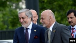 FILE: Afghan President Ashraf Ghani (R) with Chief Executive Abdullah Abdullah (L) in Poland.