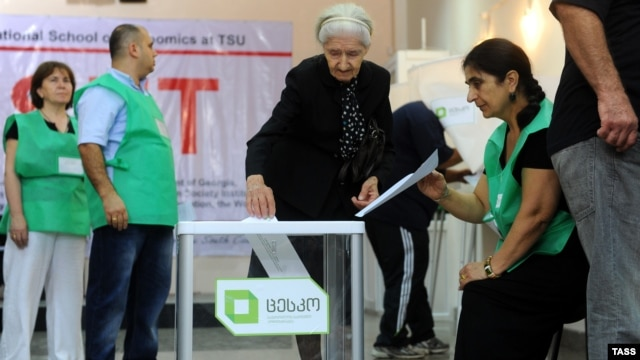 A woman casts her ballot in the capital, Tbilisi, during parliament elections in Georgia in 2012.