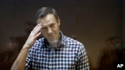 RUSSIA -- Russian opposition leader Alexei Navalny stands in a cage in the Babuskinsky District Court in Moscow, Russia, Saturday, Feb. 20, 2021. A Moscow court on Saturday considered Navalny's appeal against his prison sentence as the country faced a top