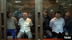 Rustam Makhmudov (far left in photo from Moscow city court on June 9) was given life in prison for pulling the trigger, and Lom-Ali Gaitukayev (second from left) got a similar sentence for organizing the killing. The other three defendants got between 12 and 20 years in jail for their roles.