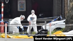 BELGIUM -- Police investigate at the scene of a shooting in Liege, May 29, 2018