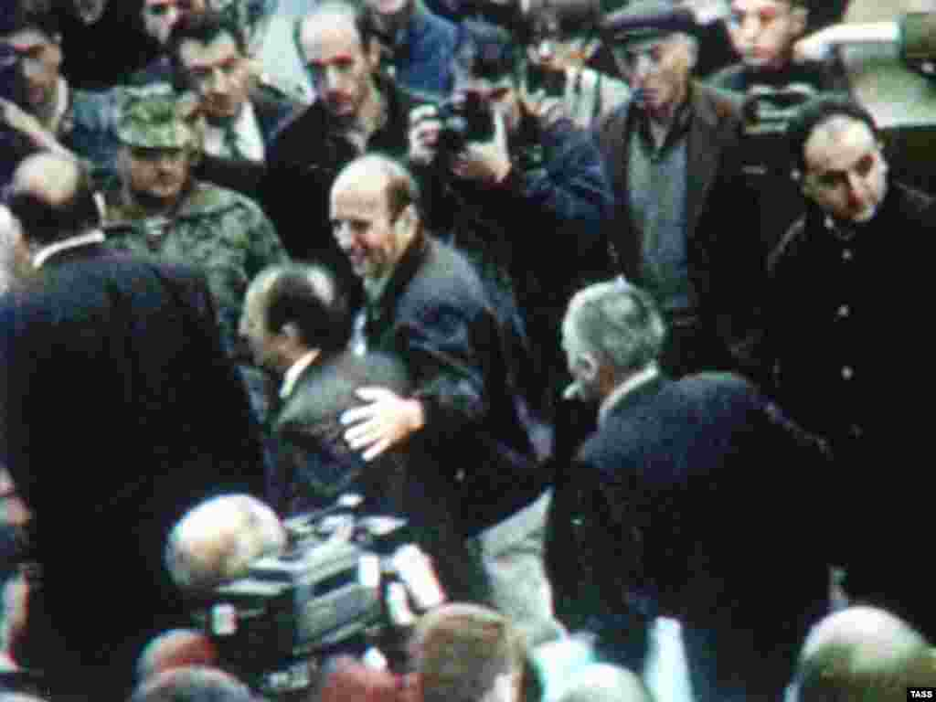 A TV grab shows a group of hostages leaving the parliament building after their release. - The attackers seized about 40 hostages but released them and surrendered to the authorities on October 28 after they received promises of a fair trial.