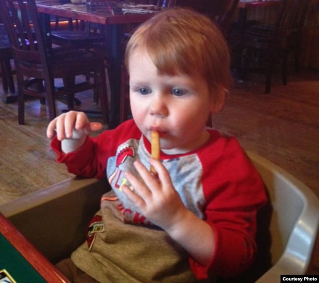 Preston Summers, who is nearly 2 years old, enjoys his first french fry at home in the United States.