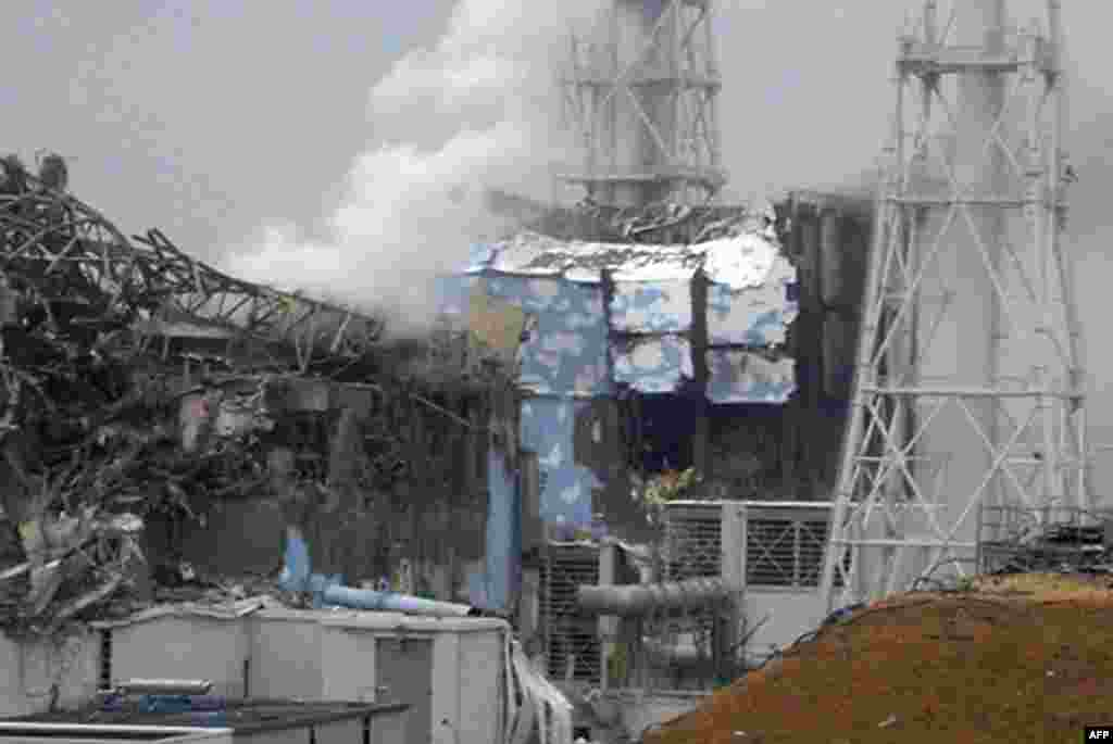 The damaged third (left) and fourth reactors of the TEPCO Fukushima No.1 power plant in Fukushima, March 2011.