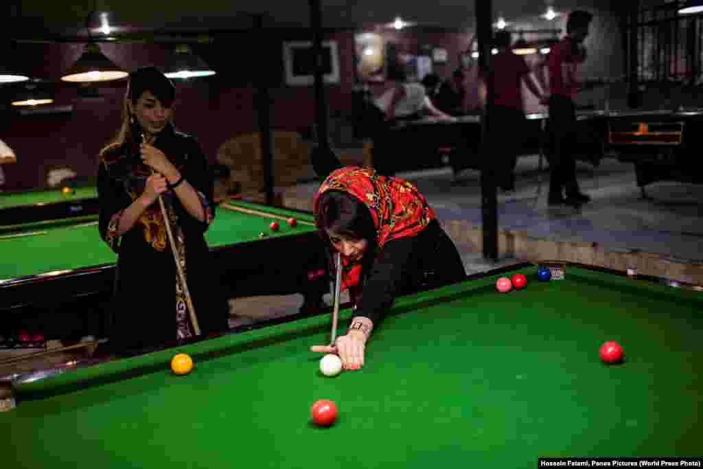 Women play pool in a men's-only gym in Iran. Long-Term Projects -- Second Prize (Hossein Fatemi, Panos Pictures)