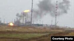 Қарашығанақтағы газ өндірісінен шыққан түтін. 25 қыркүйек 2007 жыл.