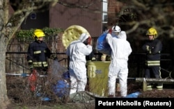 Forensic workers in the center of Salisbury, where Sergei Skripal and his daughter were found.