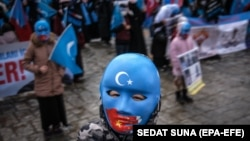 Uyghur protesters who have not heard from their families living in Xinjiang hold placards and Uyghur flags during a protest against China in Istanbul last month.