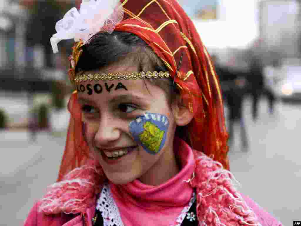 A Kosovar Albanian girl dressed in traditional costume walks on the streets of Mitrovica on February 17 during celebrations marking the third anniversary of Kosovo's unilateral declaration of independence from Serbia. Photo by Armend Nimani for AFP