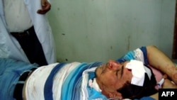 Al-Iraqiyah TV reporter Ibrahim al-Kateb, wounded in the blast, rests on a bed inside Baghdad's Yarmouk hospital.