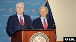 U.S. Senators McCain (left) and Lieberman address a press conference at a previous stop in Baghdad on July 3.