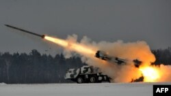 Belarus -- An army Smerch, a heavy multiple rocket launcher, fires during exercises in the Brest region, 25Jan2011