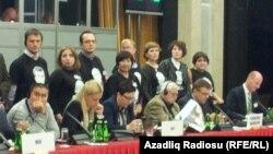 Участники акции протеста на конференции БДИПЧ ОБСЕ