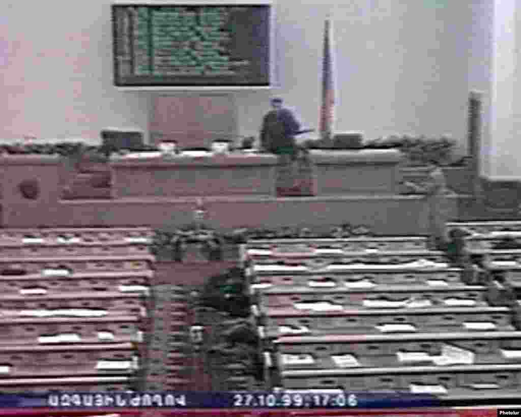 A screen grab from Armenian television shows the gunmen in the parliament chamber. - On October 27, 1999, five gunmen entered Armenia's parliament and opened fire, killing eight prominent politicians.