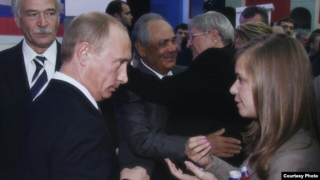 Masha Drokova (right) meets her idol, Vladimir Putin.