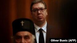 Српскиот претседател Александар Вучиќ и поглаварот на СПЦ, Иринеј, архивска фотографија.