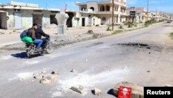 Вулиці постраждалого від авіаудару сирійського міста Хан Шейхун, 5 квітня 2017 року