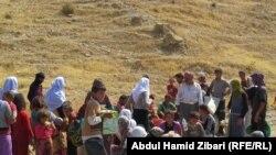 Pamje e banorëve të pjesës veriore të Irakut që ikin nga militantët e Shtetit Islamik