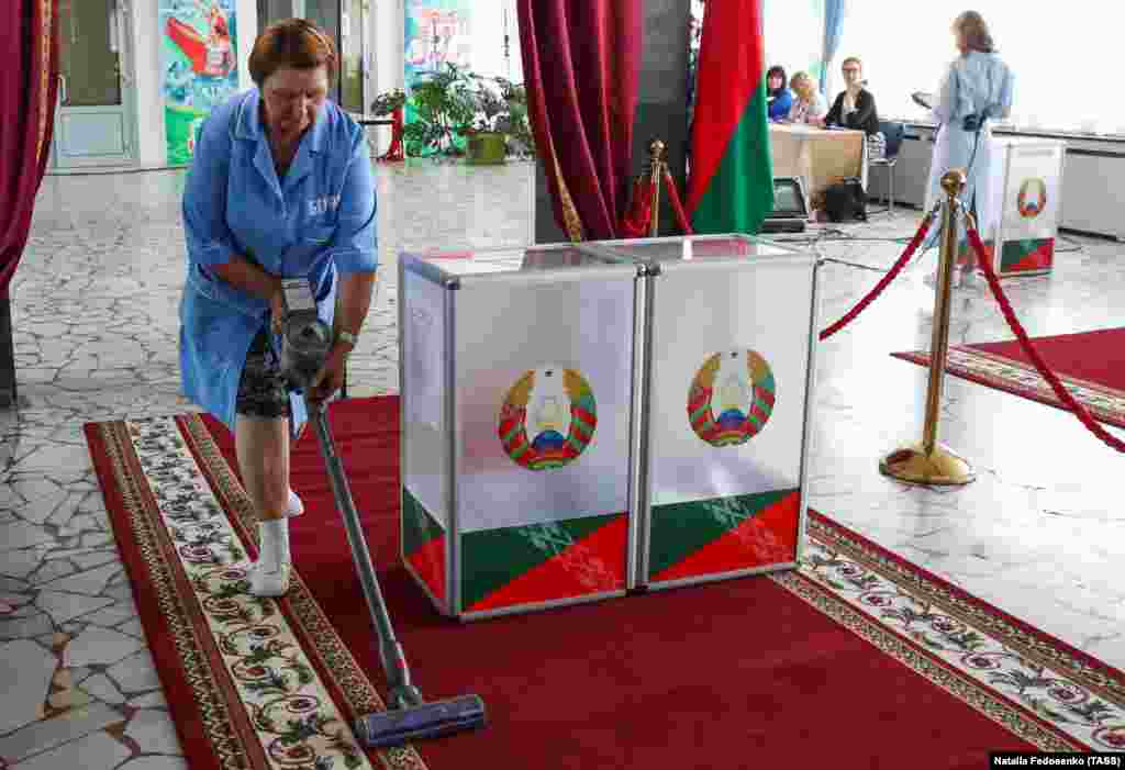 Rugs around the ballot box are cleaned at a polling station in Minsk.
