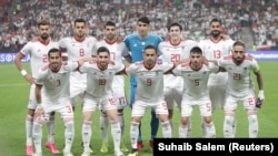 Iran soccer players pose for a team photo at the Asian Cup tournament in the United Arab Emirates.