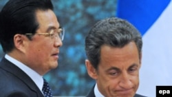 China's President Hu Jintao (left) and his French counterpart Nicolas Sarkozy are expected to sign deals worth billions.