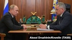 Russian President Vladimir Putin (left) and Defense Minister Sergei Shoigu met in the Kremlin on July 2.