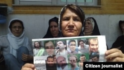 "Mokhtare, shown above at a demonstration with other relatives of political prisoners, has been jailed for speaking out about her son's imprisonment. ""We are protesting the imprisonment of our innocent children,"" she told Radio Farda."