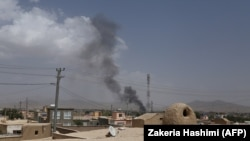 Smoke rises into the air after Taliban militants launched an attack on the Afghan provincial capital of Ghazni on August 10.