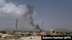 Smoke rises into the air after Taliban militants launched an attack on the Afghan provincial capital of Ghazni, August 10, 2018