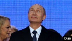 """Президент России Владимир Путин на митинге в честь годовщины """"присоединения"""" Крыма к России. Москва, 18 марта 2015 года."""