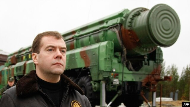 Russia's Dmitry Medvedev walks near an RS-12M Topol ballistic missile at the Plesetsk space launch pad. (file photo)