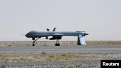 Afghanistan -- A US Predator unmanned drone armed with a missile stands on the tarmac of Kandahar military airport, 13Jun2010