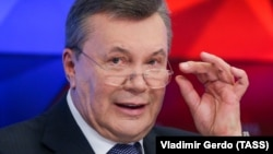 Former Ukrainian President Viktor Yanukovych talks to journalists in Moscow on February 6.