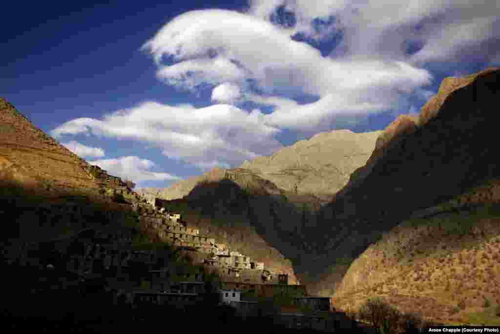 Clouds over a village in the mountainous borderlands with Iraq, near the site where three American hikers were arrested in 2009