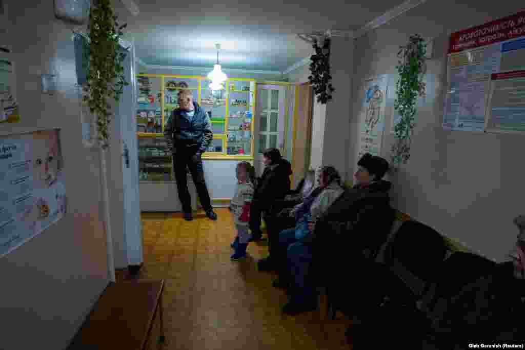 "Patients wait to see Rozumiy at his clinic in Ivankovichy. Acting Ukrainian Health Minister Ulana Surpun recently said, ""Nobody likes Ukrainian medical services today -- neither doctors nor patients."""